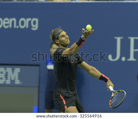 New York, NY - September 4, 2015: Rafael Nadal of Spain serves during 3rd round match against Fabio Fognini of Italy at US Open Championship - stock photo