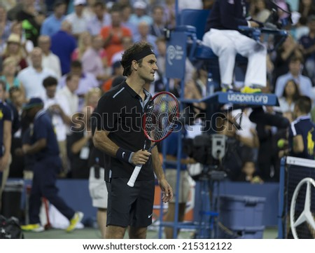 NEW YORK, NY - SEPTEMBER 4, 2014: Roger Federer of Switzerland celebrates victory of quarterfinal match against Gael Monfils of France at US Open championship in Flushing Meadows USTA Tennis Center