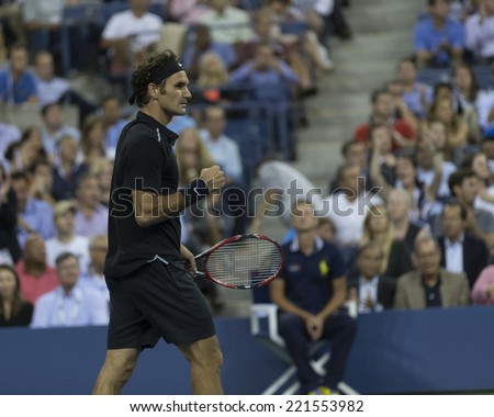 NEW YORK, NY - SEPTEMBER 4, 2014: Roger Federer of Switzerland reacts during quarterfinal match against Gael Monfils of France at US Open championship in Flushing Meadows USTA Tennis Center - stock photo