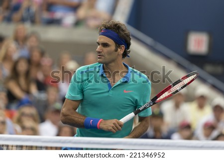 NEW YORK, NY - SEPTEMBER 6, 2014: Roger Federer of Switzerland reacts during semifinal match against Marin Cilic of Croatia at US Open championship in Flushing Meadows USTA Tennis Center - stock photo