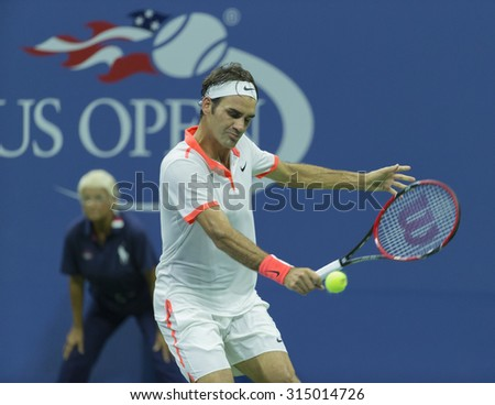 New York, NY - September 9, 2015: Roger Federer of Switzerland returns ball during quaterfinal match against Richard Gasquet of France at US Open Championship - stock photo