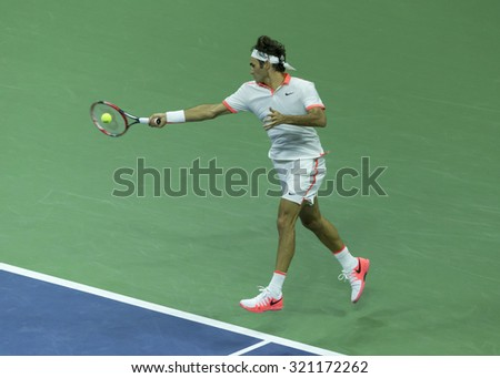 New York, NY - September 11, 2015: Roger Federer of Switzerland returns ball during semifinal against Stan Wawrinka of Switzerland at US Open Championship on Ash stadium - stock photo