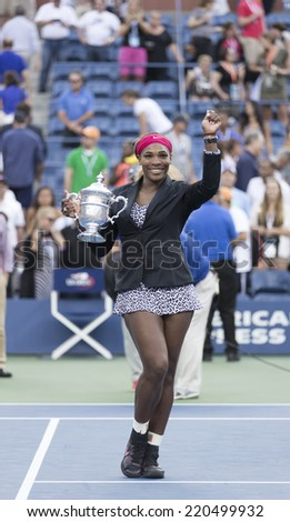 NEW YORK, NY - SEPTEMBER 7, 2014: Serena WIlliams of USA celebrates winning final match against Caroline Wozniacki of Denmark at US Open championship in Flushing Meadows USTA Tennis Center - stock photo