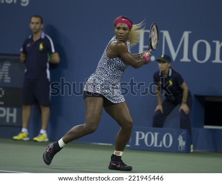 NEW YORK, NY - SEPTEMBER 3, 2014: Serena Williams of USA returns ball during quarterfinal match against Flavia Pennetta of Italy at US Open championship in Flushing Meadows USTA Tennis Center - stock photo