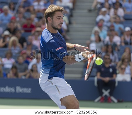 New York, NY - September 7, 2015: Stan Wawrinka of Switzerland returns ball during 4th round match against Donald Young of USA at US Open Championship - stock photo