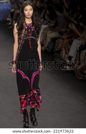NEW YORK, NY - SEPTEMBER 10, 2014: Sung Hee walks the runway at Anna Sui fashion show during Mercedes-Benz Fashion Week Spring 2015 at The Theatre at Lincoln Center - stock photo
