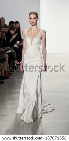 New York, NY, USA - April 12, 2014: A model walks the runway for the Kenneth Pool collection by Amsale during New York International Bridal Week at the EZ-Studios, Manhattan