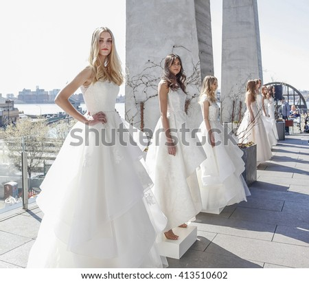 New York, NY, USA - April 15, 2016: Models show up wedding dress for RIVINI & Alyne Spring 2017 Bridal Collection by Rita Vinieris at The Standard, High Line during New York International Bridal week, - stock photo