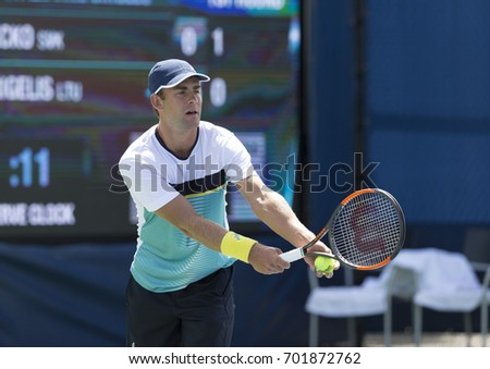 New York, NY USA - August 23, 2017: Laurynas Grigelis of Lithuania serves during qualifying game against Lucas Lacko of Slovakia at US Open 2017