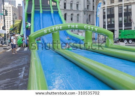 New York, NY USA - August 15, 2015: Vita Coco sponsoring water slide as part of New York summer streets program on Foley Square - stock photo