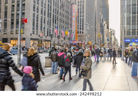 New York, NY, USA - December 27, 2014: Sixth Avenue in Midtown Manhattan packed with Locals and Tourists during the Christmas Holidays. More than 50 million people visit New York every year.  - stock photo