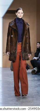 New York, NY, USA - February 15, 2015: A model walks runway for Derek Lam FW15 Runway show during Mercedes-Benz Fashion Week New York at the 545 West 22nd Street, Manhattan - stock photo