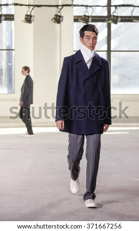 New York, NY, USA - February 2 2016:A model walks runway for Duckie Brown Fall 2016 runway show during NY Fashion Week Men's at Skylight Clarkson North, Manhattan
