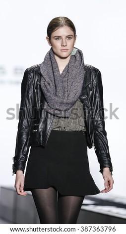New York, NY, USA - February 16, 2016: A model walks runway rehearsal at Dennis Basso runway show during of Fall/Winter 2016 New York Fashion Week at The Arc, Skylight at Moynihan Station, Manhattan. - stock photo