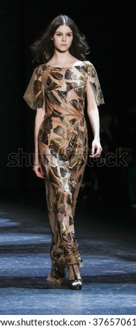 New York, NY, USA - February 13, 2016: A model walks tterunway at Monique Lhuillier runway show during of Fall/Winter 2016 New York Fashion Week at The Arc, Skylight at Moynihan Station, Manhattan. - stock photo