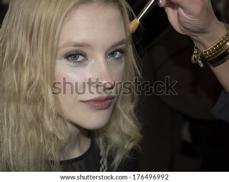 New York, NY, USA - February 09, 2014: Model prepares backstage for Tracy Reese Fall/ Winter 2014 Runway show during Mercedes-Benz Fashion Week New York at Center 548, Manhattan - stock photo