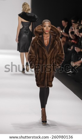New York, NY, USA - February 19, 2015: Model walks runway for Hallie Sara Fall 2015 collection at Art Hearts Fashion Presented By AHF during Mercedes-Benz Fashion Week at The Theatre at Lincoln Center