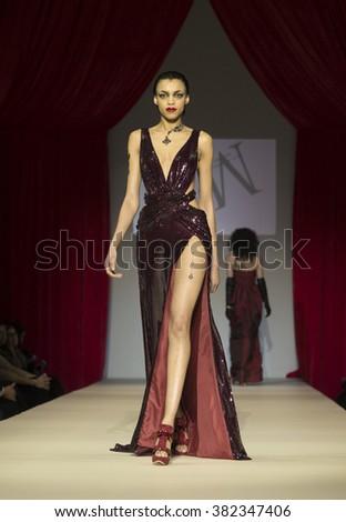 New York, NY USA - February 11, 2016: Model walks runway for Homme by Malan Breton during New York Fall 2016 fashion week at Gotham Hall - stock photo