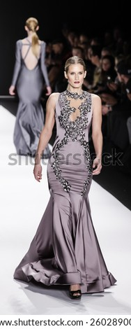 New York, NY, USA - February 19, 2015: Model walks runway for Walter Mendez Fall 2015 collection at the Art Hearts Fashion Presented By AHF during Mercedes-Benz FW at The Theatre at Lincoln Center - stock photo