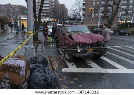New York, NY USA - January 2, 2017: Aftermath of car accident in the Bronx when driver lost control in rainy day and  broke into pizza store & nail spa fortunately nobody was hurt