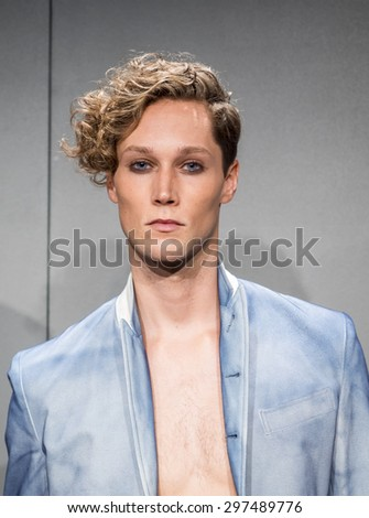 New York, NY, USA - July 16, 2015: A model poses at the deTROIT mensweare collection presentation by John Varvatos during New York Fashion Week: Men's S/S 2016 at Skylight Clarkson Sq, Manhattan