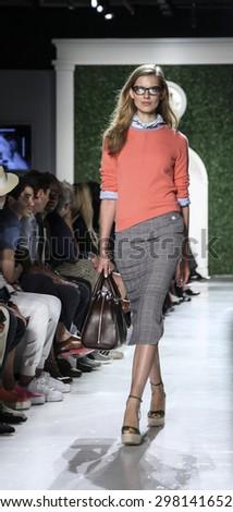 New York, NY, USA - July 15, 2015: A model walks runway at the Michael Bastian Runway show during New York Fashion Week: Men's S/S 2016 at Skylight Clarkson Sq, Manhattan - stock photo