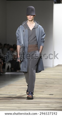 New York, NY, USA - July 14, 2015: A model walks runway at the Robert Geller Runway show during New York Fashion Week: Men's S/S 2016 at Skylight Clarkson Sq, Manhattan