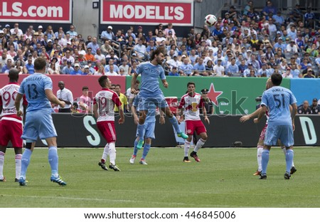 New York, NY USA - July 3, 2016: Andrea Pirlo (21) of New York Football Club controls air ball during MLS soccer game against New York Red Bulls at Yankee stadium NYC FC won 2 - 0