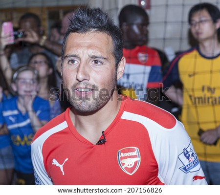 New York, NY, USA - July 25, 2014: Arsenal player Santi Cazorla attends PUMA partners with Arsenal Football Club to Debut Monumental Cannon event in Grand Central Station in New York City. - stock photo