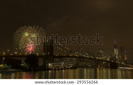 New York, NY USA - July 4, 2015: View of lower Manhattan skyline with Brooklyn bridge and One World Trade Center during Macy's 4th of July fireworks - stock photo