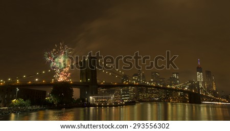 New York, NY USA - July 4, 2015: View of lower Manhattan skyline with Brooklyn bridge and One World Trade Center during Macy's 4th of July fireworks