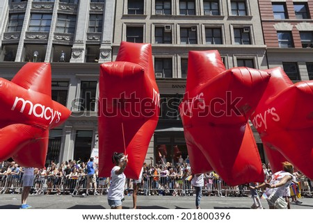 New York, NY USA - June 29, 2014: Atmosphere during annual 44th Pride Parade on Fifth Avenue with sponsor Macy's in Manhattan - stock photo
