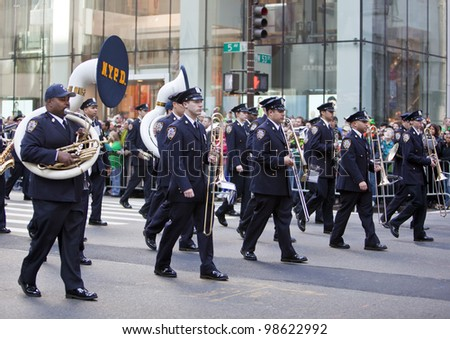NEW YORK, NY, USA MAR 17: NYPD marching band policemen at the St. Patrick's Day Parade on March 17, 2012 in New York City, United States.