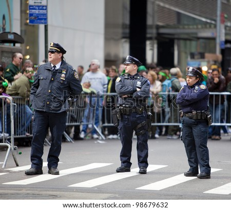 NEW YORK, NY, USA - MAR 17: NYPD policemen at the St. Patrick's Day Parade on March 17, 2012 in New York City, United States.