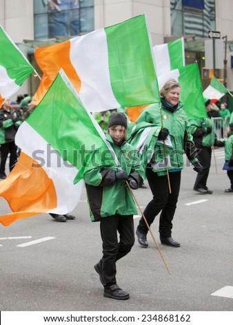 NEW YORK, NY, USA - MAR 17, 2014: The annual St. Patrick's Day Parade along fifth Avenue in New York City. - stock photo