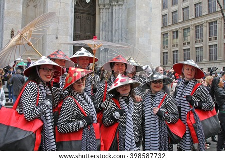 New York, NY USA- March 27, 2016: Group of women in the same costumes pose for a group photo during the Easter Bonnet Parade on Fifth Avenue. - stock photo