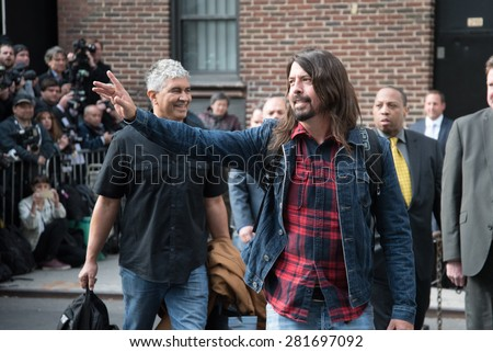 New York, NY / USA - May 20, 2015: David Grohl and Pat Smear of Foo Fighters leaving the Ed Sullivan Theater after their performance on the final episode of Late Night With David Letterman. - stock photo