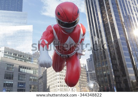 New York, NY USA - November 26, 2015: Giant Red Mighty Morphin Power Ranger balloon flown at the 89th Annual Macy's Thanksgiving Day Parade on Columbus Circle - stock photo