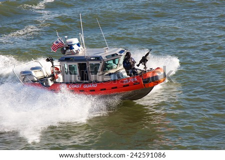 NEW YORK, NY, USA - NOVEMBER 21, 2012: United States Coast Guard boat steaming through the water of New York Harbor in New York, NY, USA on November 21, 2012. - stock photo