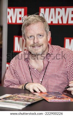 New York, NY, USA - October 11 2014: Marvel artist Marc Bagley signs comic book at Comic Con 2014 at The Jacob K. Javits Convention Center in New York City