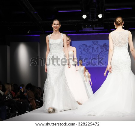 New York, NY, USA - October 11, 2015: Models walk runway for Privato by Mon Cheri 2016 Bridal Collection during New York International Bridal Week at the Fashion Theater, Pier 94, Manhattan