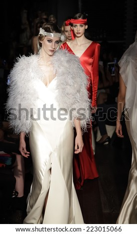 New York, NY, USA - October 9, 2014: Models walk runway for the Exclusive Launch of Johanna Johnson red carpet & Bridal Spring/Summer 2015 Starlet Collection at the Exclusive Parlor members Club - stock photo