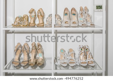New York, NY, USA - October 5, 2016: Shoes on backstage display for Marchesa Fall/Winter 2017 Bridal Presentation at Canoe Studio, Manhattan