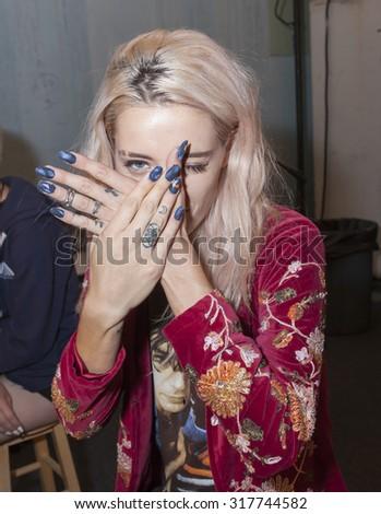 New York, NY, USA - September 10, 2015: A model prepares backstage at Desigual runway show during of Spring 2016 New York Fashion Week at The Arc, Skylight at Moynihan Station, #NYFW, #Desigual,  - stock photo