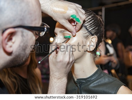 New York, NY, USA - September 12, 2015: A model prepares backstage at Monique Lhullier runway show during Spring 2016 New York Fashion Week at The Arc, Skylight at Moynihan Station, #CFDANYFW, #NYFW,