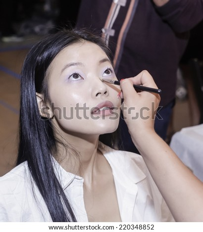 New York, NY, USA - September 05, 2014: Model prepares backstage for Sally LaPointe Spring 2015 Collection  Runway show during Mercedes-Benz Fashion Week New York at Skylight Modern, Manhattan - stock photo