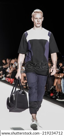 New York, NY, USA - September 08, 2014: Model walks runway wearing Control Sector at  Art Hearts fashion show presented by AIDS Healthcare Foundation during NBFW SS 2015 at Theatre at Lincoln Center - stock photo