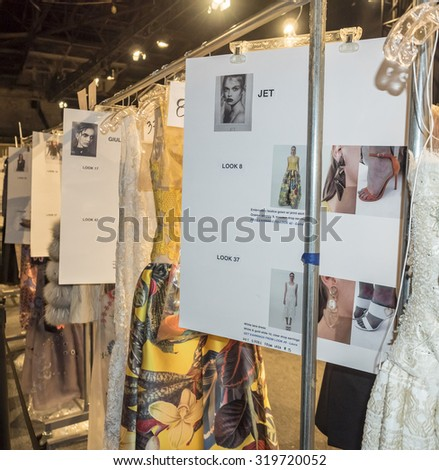 New York, NY, USA - September 15, 2015: Racks with dresses on backstage at Dennis Basso runway show during of Spring 2016 New York Fashion Week at The Arc, Skylight at Moynihan Station, #DENNISBASSO - stock photo