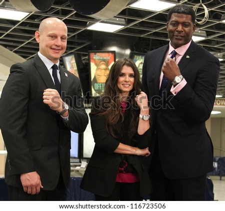 NEW YORK-OCT 25: Adam Graves, Danica Patrick and Larry Johnson attend unveiling of new Tissot Swiss Watches Lobby Clocks at Madison Square Garden Box Office on October 25, 2012 in New York City. - stock photo