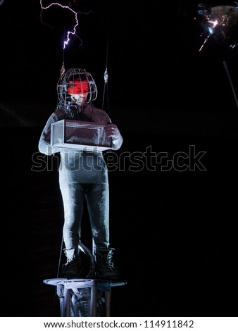 NEW YORK - OCT 6: Endurance artist David Blaine is struck by a spark of electric current from a Tesla coil during the live streaming event called 'Electrified' in New York on October 6, 2012. - stock photo